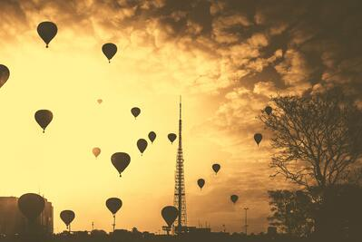 Hot air balloons in the sky against a sunset