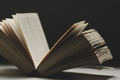 Book falling open with pages spread