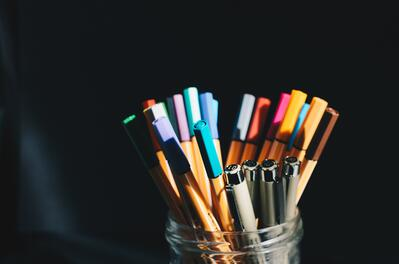 coloured pens in a jar