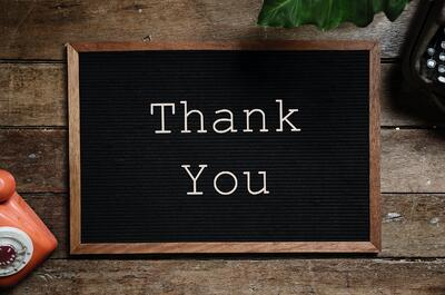A board with letters spelling out thank you