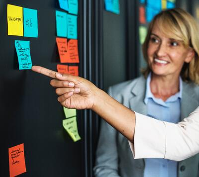 Team works together with coloured post-its
