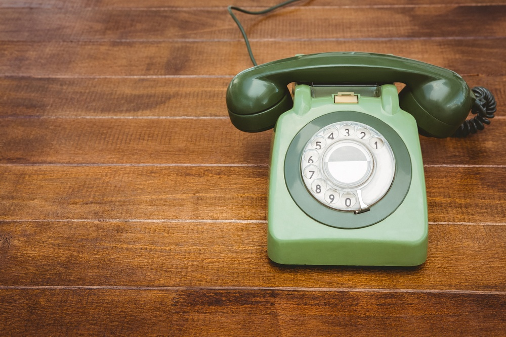View of an old phone on wood desk-1