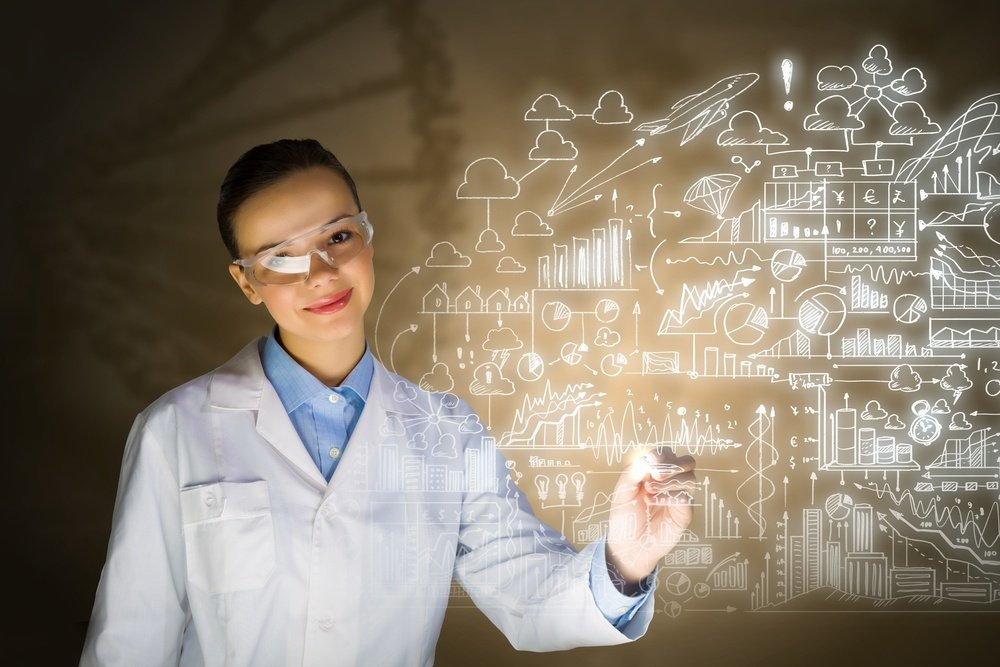 Young woman researcher in medical uniform drawing chemistry formulas